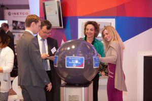 people interacting with globe display