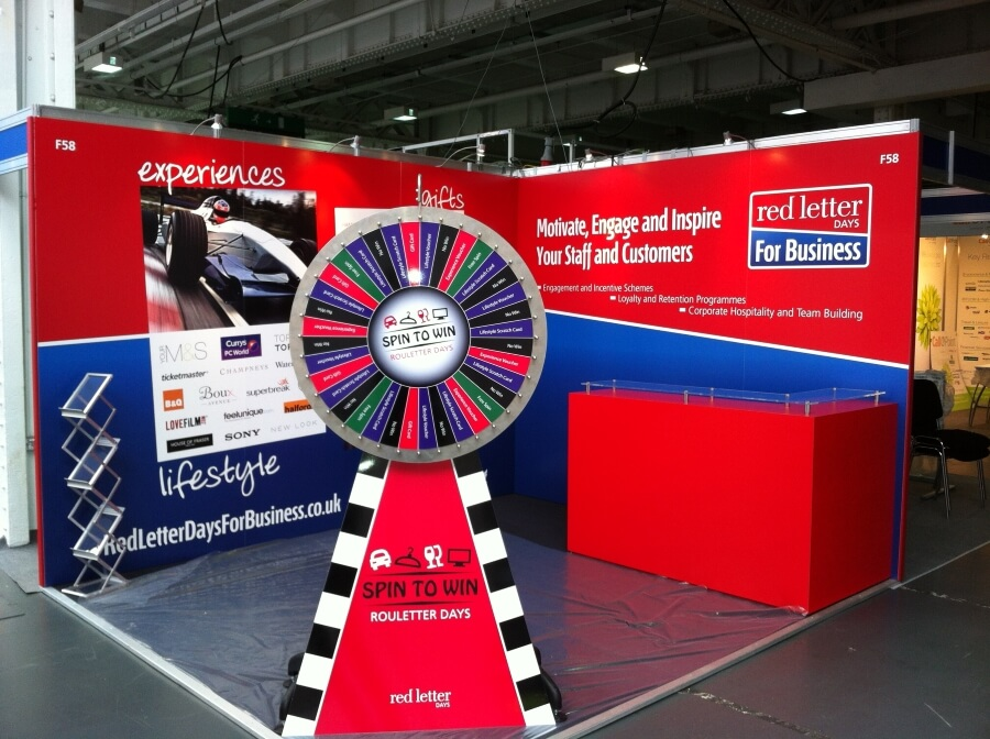 Exhibition Stand Games : Employee benefits live exhibition stand design and build